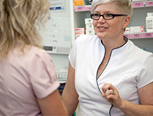 Pharmacist speaking with female customer