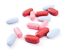 Close up of a pile of coloured medicine caplets