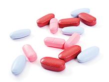 Close up of a pile of coloured medicine caplets