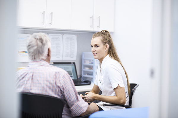 Female Pharmacist consulting with a customer